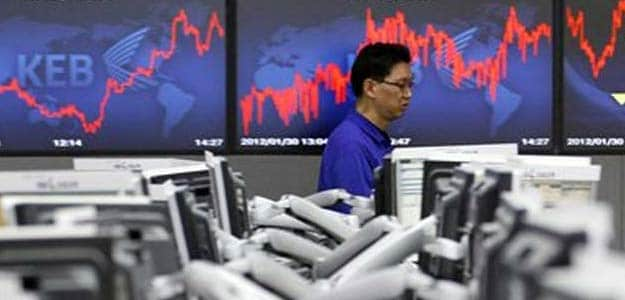 Asian shares off highs, Fed's stance underpins markets