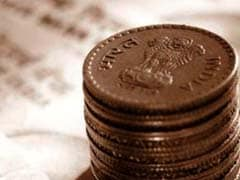 Rupee recovers from historic lows, ends FY14 with 10 per cent loss