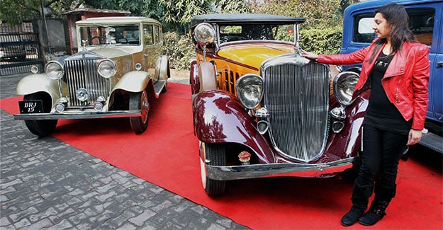 A visitor admires a 1933 Hudson - the only Hudson left in the world - at a press conference to announce the rally in New Delhi