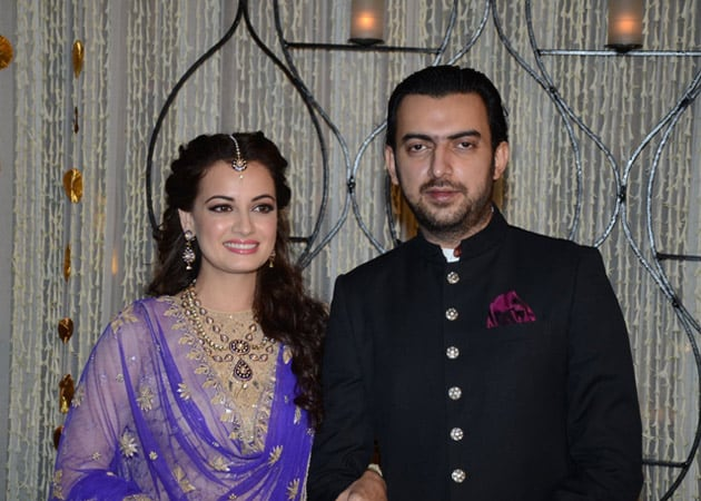 Dia Mirza And Sahil Sangha Pose For The Photographers At Their Sangeet Ceremony Preluding Wedding In Delhi