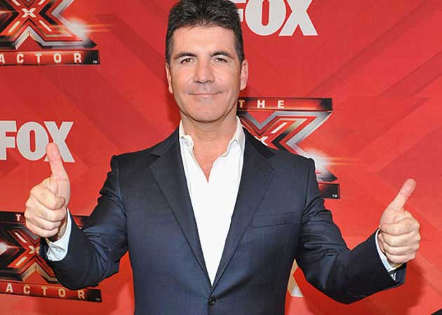 Simon Cowell Says He is World's Most Eligible Bachelor