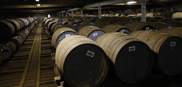 Whisky barrels are seen in the warehouse of the Diageo Cardhu distillery in Scotland