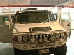 After Businessman Drove Hummer Into Guard, He's Fighting for Life