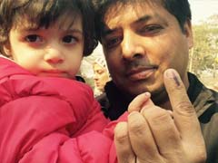 Delhi Elections 2015: Excited Children Accompany Parents to Polling Booths