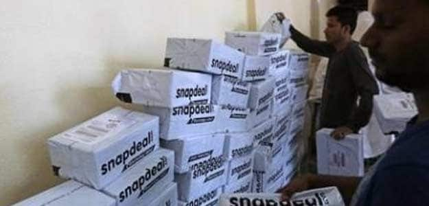 Employees of Snapdeal sort out delivery packages inside their company fulfilment centre