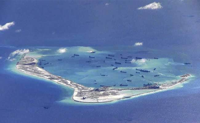 South China Sea Tensions Surge As China Lands Plane On Artificial Island