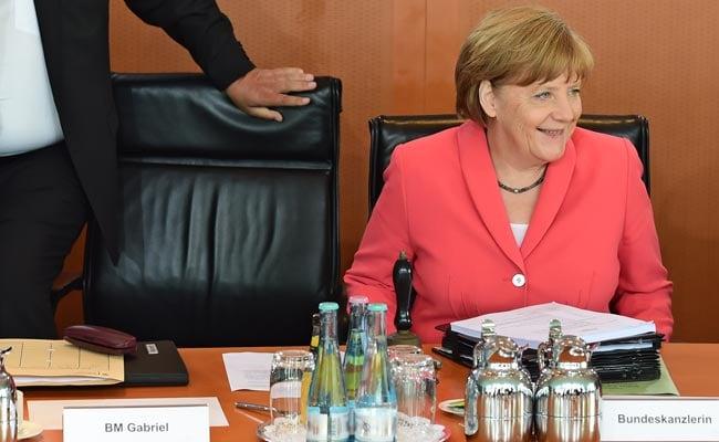 German Chancellor Merkel Says European Union's Asylum Rules 'Obsolete'