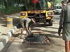 A Python Is 'Swallowing' Bengaluru's Potholes One at a Time