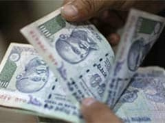 Rupee Falls 34 Paise to Trade Over 28-Month Low at 67.99/Dollar