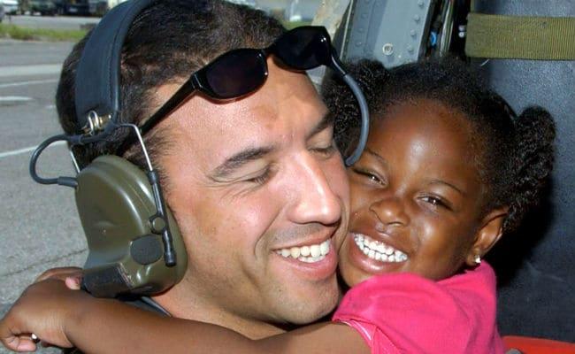 Rescuer To Meet Kid From Hurricane Katrina Hug Photo