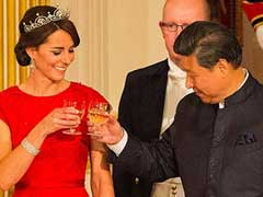 Kate Middleton's Red Dress Wins Over China as Cameron Cheer Hides Disquiet