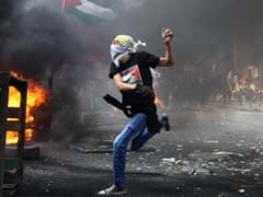 Israeli Strike Kills 2 Palestinians in Gaza as Unrest Spirals