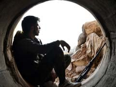 Syrian Rebels Hand In Heavy Weapons In Besieged Damascus Town