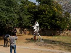 Row Over Hanging of Dummy Cow at Jaipur Art Summit
