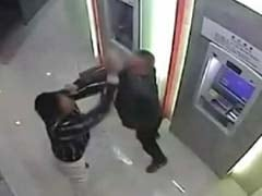 Watch: Chinese Man Beats 'Robber' Blue at an ATM Machine