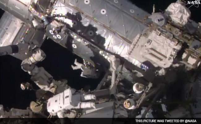US Astronauts Begin Spacewalk To Fix Stalled Rail Car
