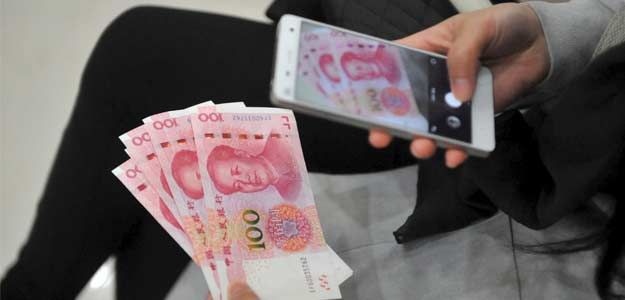 China Lets Yuan Fall Faster, Share Trading Suspended As Prices Crash