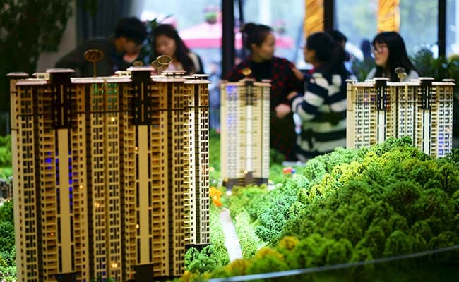 China Challenge: Getting Poor Migrant Workers To Buy Vacant Homes
