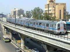 Man Obstructs Delhi Metro's Run By Walking On Track