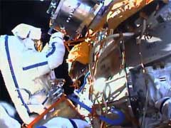 Russians Go Spacewalking To Collect Experiments, Test Glue