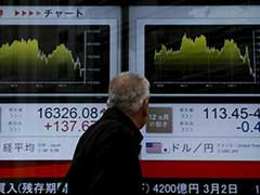 Asia Shares Fall Nearly 1% As Weak Results Halt Bull Run On Wall Street