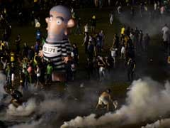 Police Fire Tear Gas At Protests Against Brazil's President
