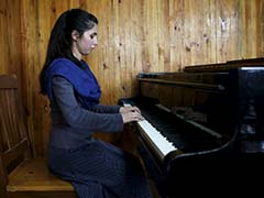 Afghan Teenager Braves Threats, Family Pressure To Lead Women's Orchestra
