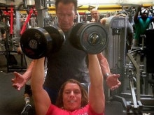 Pic of Schwarzenegger Training His Son Will Inspire You to Hit the Gym