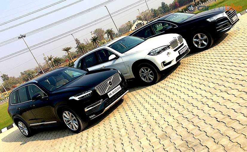 comparison review audi q7 vs bmw x5 vs volvo xc90 ndtv carandbike. Black Bedroom Furniture Sets. Home Design Ideas