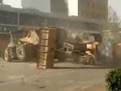 Only in China: 6 Bulldozers Fight it out on the Street in Viral Video