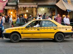 Iranian Driver Turns Cab Into Library