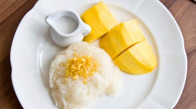 This Delicious Thai Dessert Is Commonly Known As Khao Neow Ma Muang And Combines Mangoes Sticky Rice And Creamy Coconut Milk