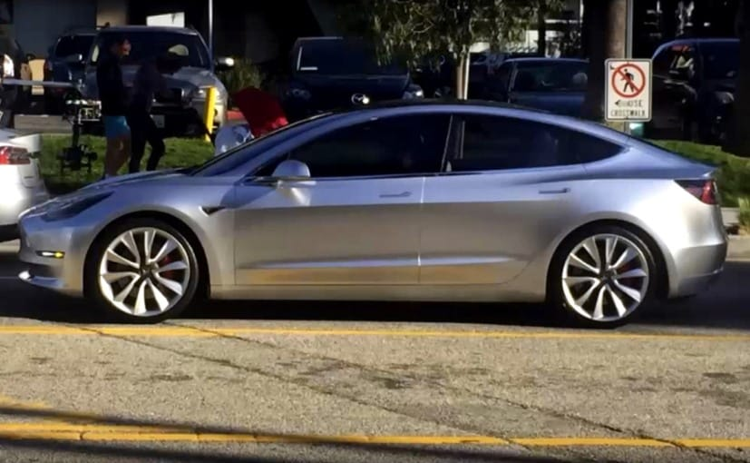 tesla model 3 spotted on road for the first time during video shoot news. Black Bedroom Furniture Sets. Home Design Ideas