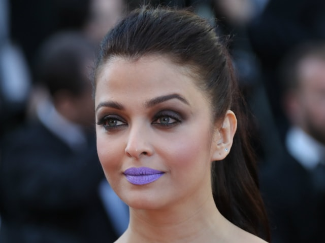 Abhishek Bachchan Describes Aishwarya's Purple Pout in One Word