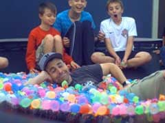 Video Shows Kids Jumping on Trampoline With 1500 Water Balloons on it