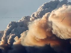 Helicopters Lead Convoy Through Fire-Ravaged Canadian City