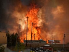 Canadians Drive Through Burning City Seeking Safety