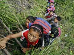 Here, Children Climb 2,625-Foot Ladder To Get To School. One Way.