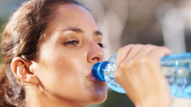 Image result for pregnant woman drinking from plastic bottles