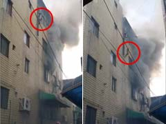 Terrifying Moment Mom Throws Kids Out of Burning Building in South Korea