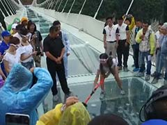 Tourists Test The Safety of 984-Foot High Chinese Glass Bridge - With Sledgehammers