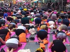 Thousands Of Yogis Hit Times Square To Welcome Summer