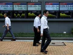 Asian Shares Edge Up As Wall Street Extends Record Rise