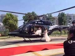Bride and Groom Hold Up Traffic to Board Helicopter on Busy Road