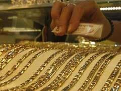 Gold Eases On Firm Dollar, Stocks; Fed Rate Policy In Focus