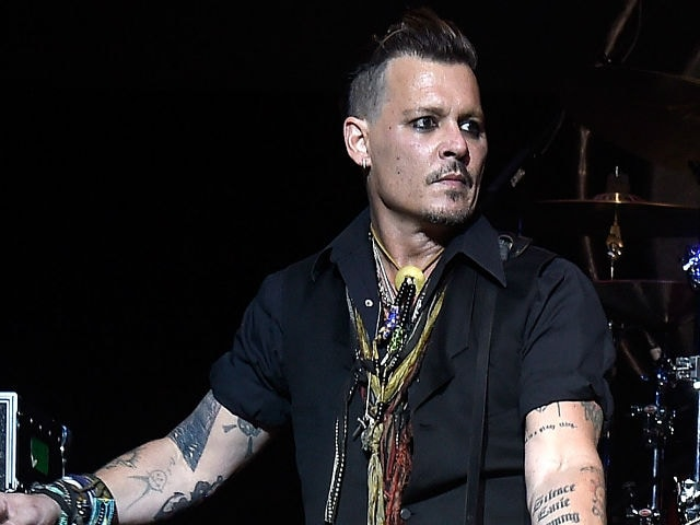 Johnny Depp photographed during a concert in New York. (Image courtesy ... Johnny Depp