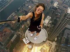 This Woman's Dizzying 'Rooftopping' Pics Are Both Brilliant And Scary