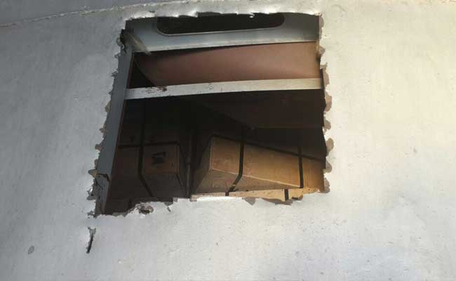 Cutting a hole in train roof, robbers escape with RBI's cash