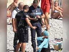 Viral Photos Of Woman Surrounded By Cops Add Fuel To French Burkini Debate