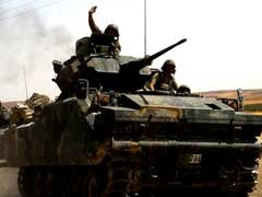 Turkey Ratchets Up Syria Offensive, Says Warplanes Hit Kurdish Militia